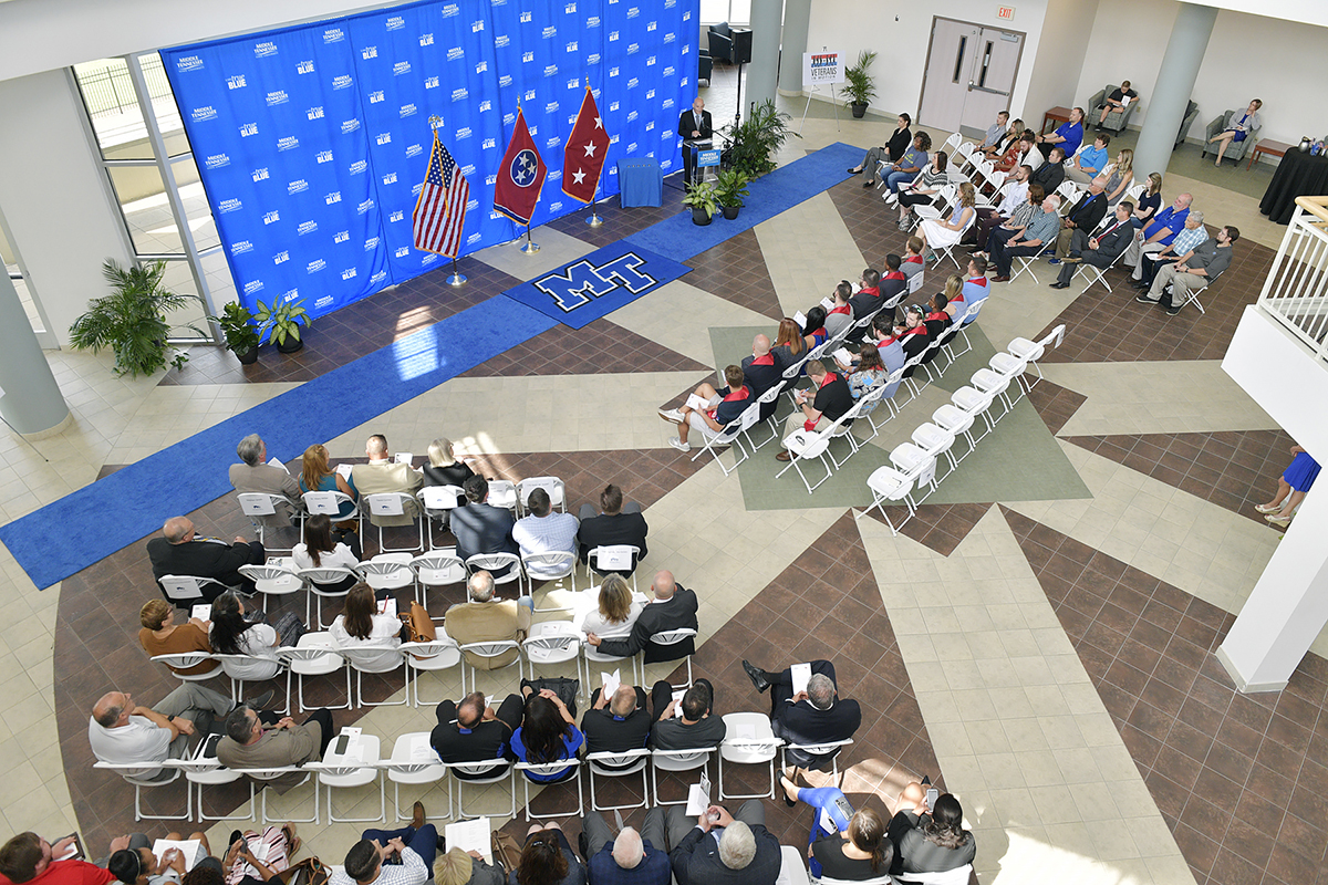 An overview showing the crowd attending the Charlie and Hazel Daniels Veterans and Military Family Center's 14th Graduating Veterans Stole Ceremony Thursday, Aug. 1, in the Miller Education Center atrium. The students received red stoles they can wear when they graduate Saturday, Aug. 10, in Murphy Center. (MTSU photo by Andy Heidt)