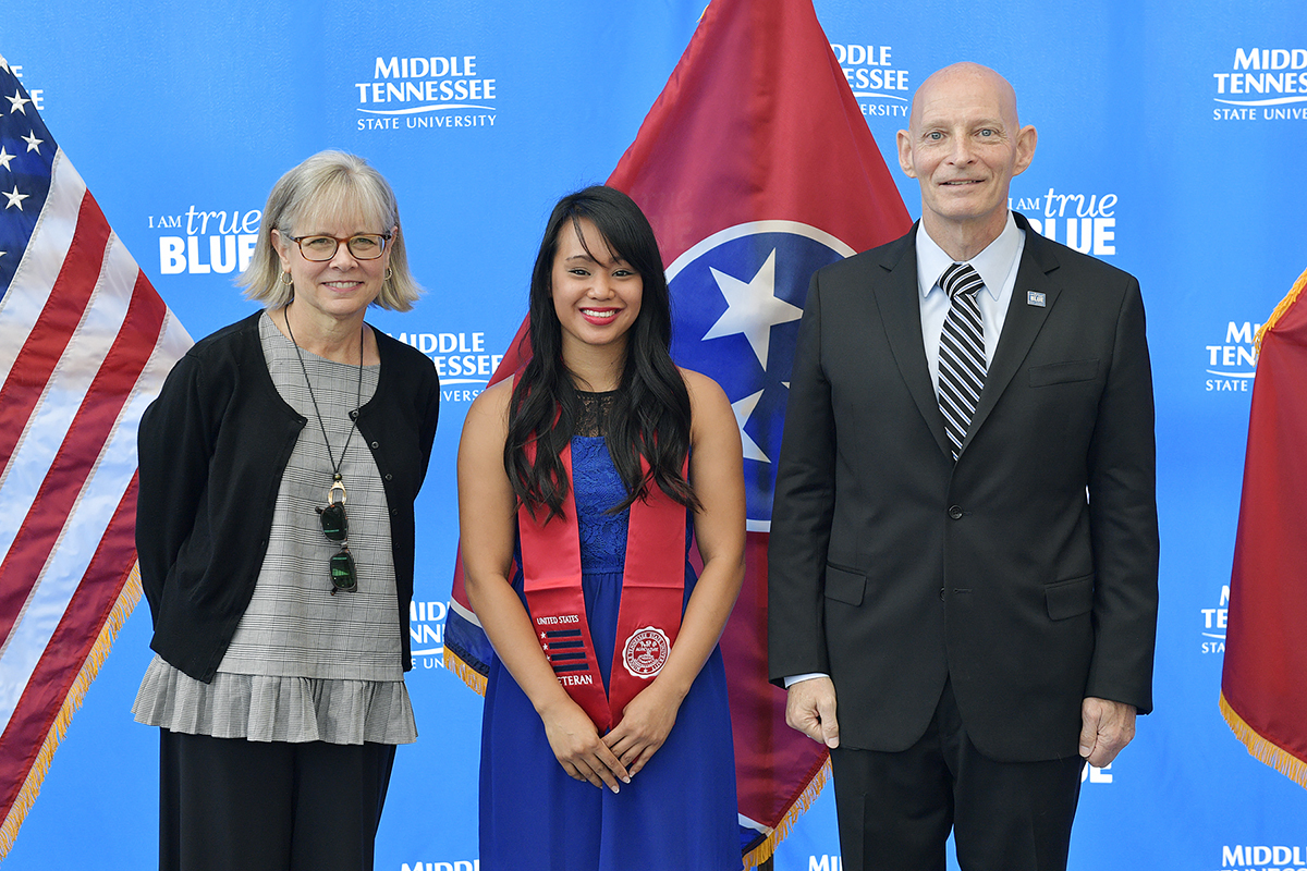 Deb Sells, left, MTSU's vice president of Student Affairs and vice provost for Enrollment and Academic Services, Thuylinh Tran and Keith M. Huber, senior adviser for veterans and leadership initiatives and a retired U.S. Army lieutenant general, are pictured during the formal Graduating Veterans Stole Ceremony in early August in the Miller Education Center atrium and hosted by the Charlie and Hazel Daniels Veterans and Military Family Center. (MTSU file photo by Andy Heidt)