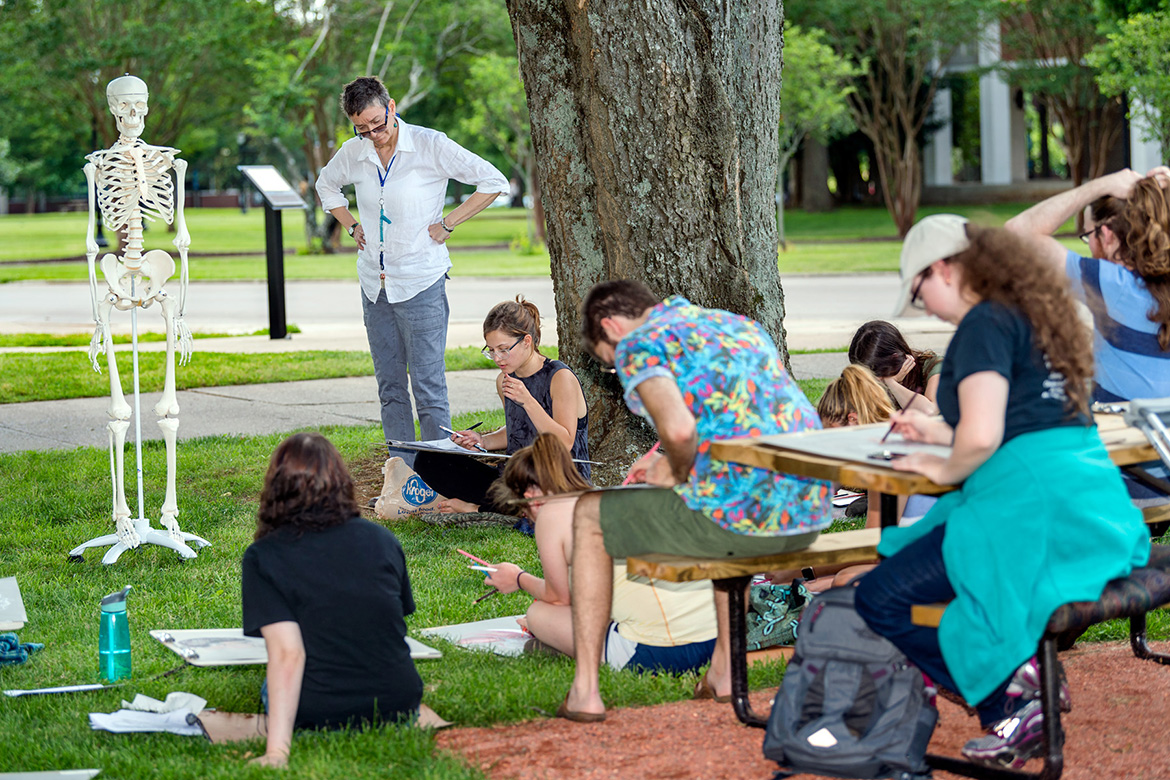 "In this file image, art faculty Tanya Tewell teaches a figure drawing class working with ""Stanley the skeleton"" on the Jones Hall lawn. (MTSU file photo by J. Intintoli)"