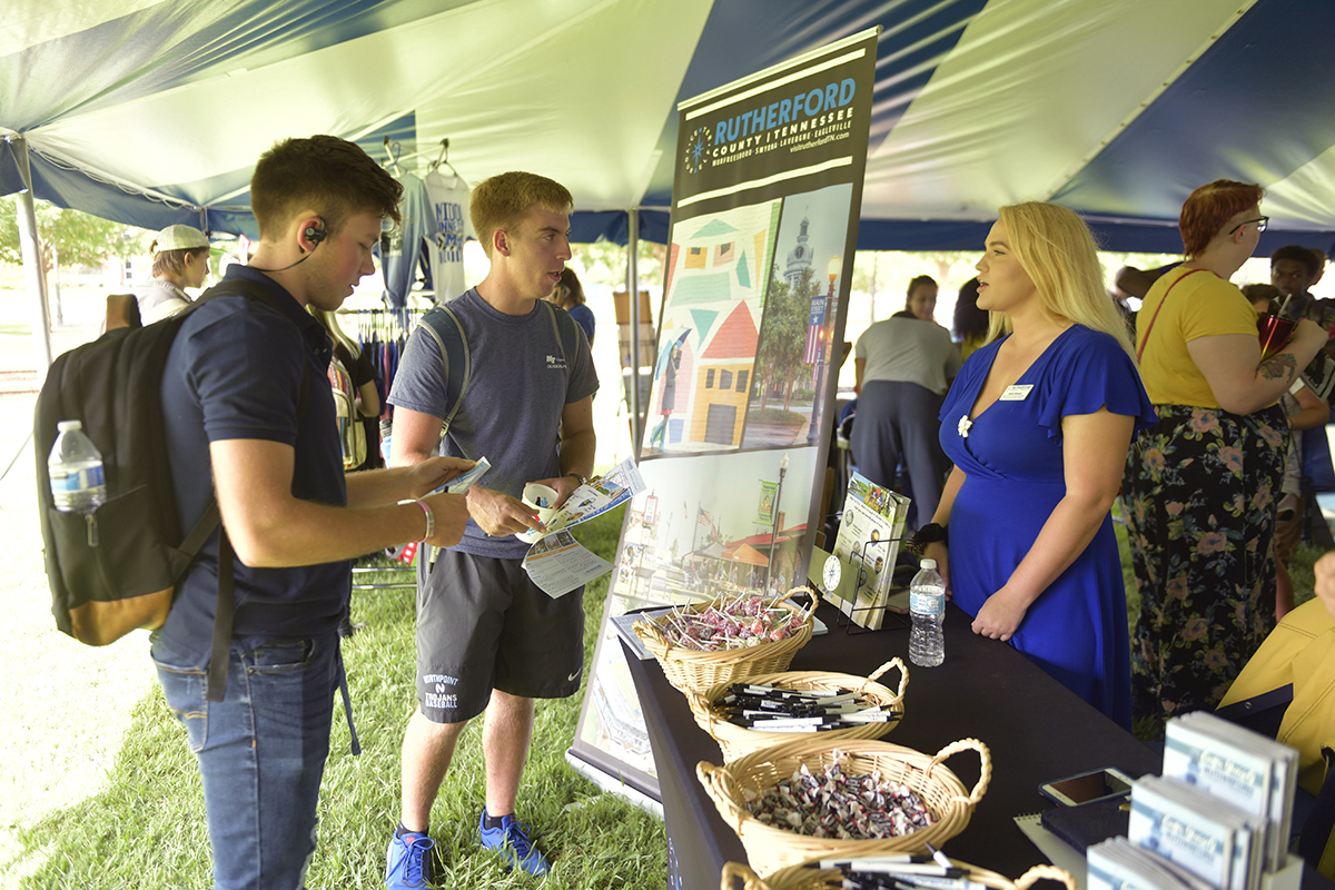 Abbie Wheeler, right, director of marketing and communications with the Rutherford County Chamber of Commerce, discusses the many offerings available to MTSU students, including Derek Green, left, of Knoxville, Tenn., and Payne Pignocco, 18, of Olive Branch, Miss., Tuesday, Aug. 27, during the annual Meet Murfreesboro in the Student Union Commons. Both are freshmen aerospace majors — Green in flight dispatch and Pignocco in professional pilot. (MTSU photo by James Cessna)