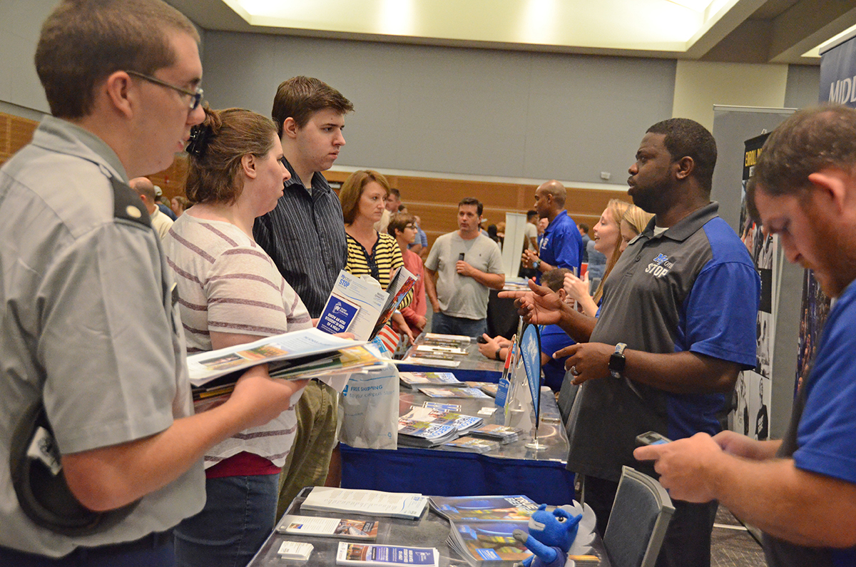 Chris Rochelle, second from right, enrollment coordinator with the MT One Stop, provides information and answers questions from prospective students and their parents attending the 2018 Rutherford County College Night. Guests will return for this year's college night starting at 6 p.m. Wednesday, Sept. 4, in the Student Union Ballroom. (MTSU file photo by Randy Weiler)
