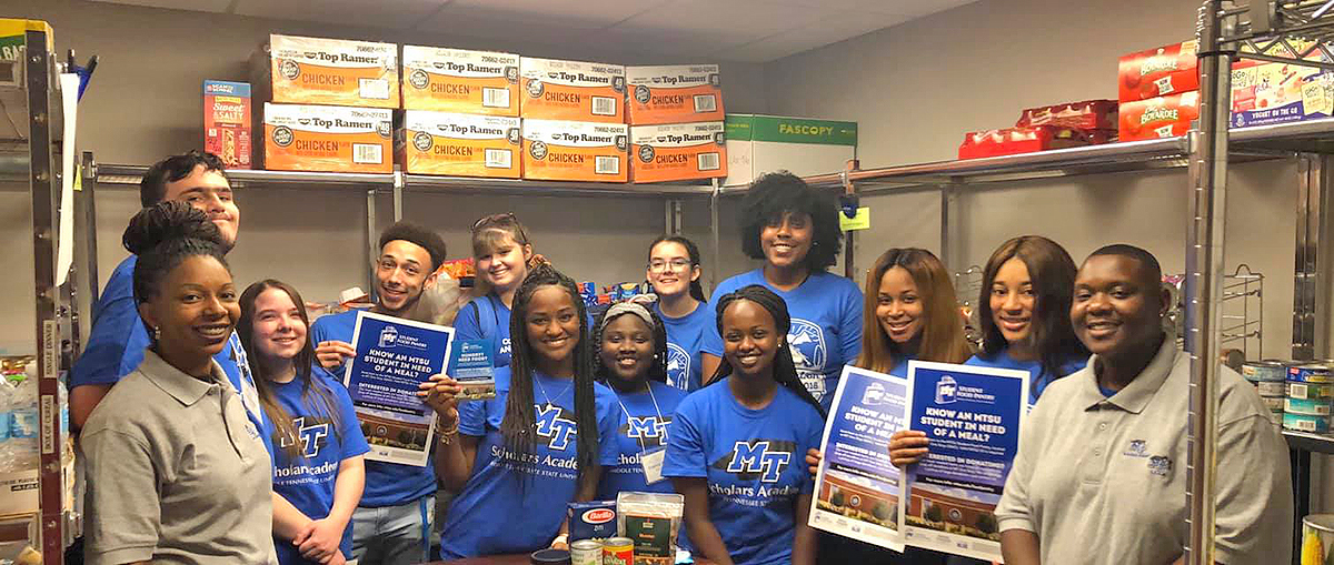 A group of Scholars Academy freshmen and leaders lent a helping hand, bringing donations to the MTSU Food Pantry. (Submitted photo)