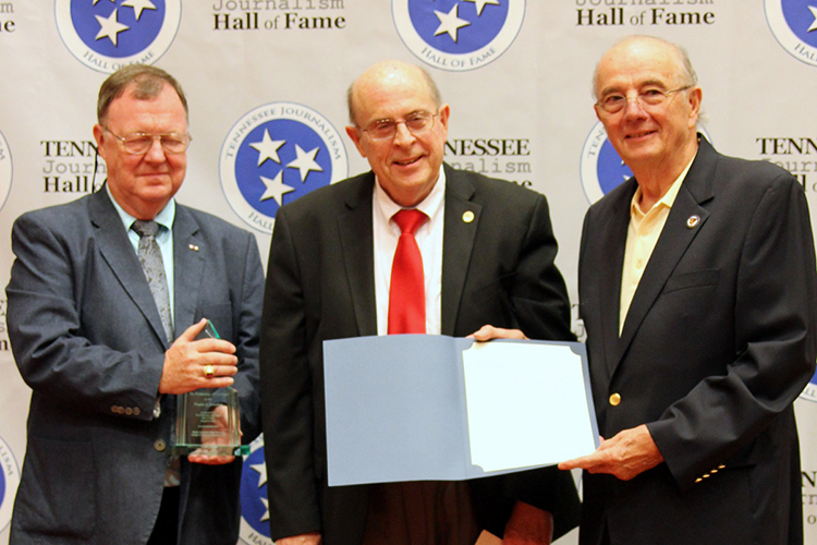 Earl Freudenberg, veteran Chattanooga, Tenn., radio and television broadcaster, receives his award and certificate during the induction ceremony for the 2019 class of the Tennessee Journalism Hall of Fame held Tuesday, Aug. 6, at Embassy Suites in Murfreesboro, Tenn. Shown with him are Hooper Penuel, right, TJHOF co-founder and secretary, and TJHOF President Larry Burriss. (Submitted photo)