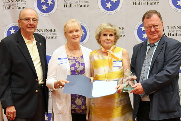 "Debbie O'Donnell, second from right, niece of the late Francis ""Red"" O'Donnell, accepted the posthumous award and certificate on behalf of the Nashville Banner columnist during the induction ceremony for the 2019 class of the Tennessee Journalism Hall of Fame held Tuesday, Aug. 6, at Embassy Suites in Murfreesboro, Tenn. Shown with her are sister Lee O'Donnell Gallagher, Hooper Penuel, far left, and TJHOF co-founder and secretary, and TJHOF President Larry Burriss, right. (Submitted photo)"
