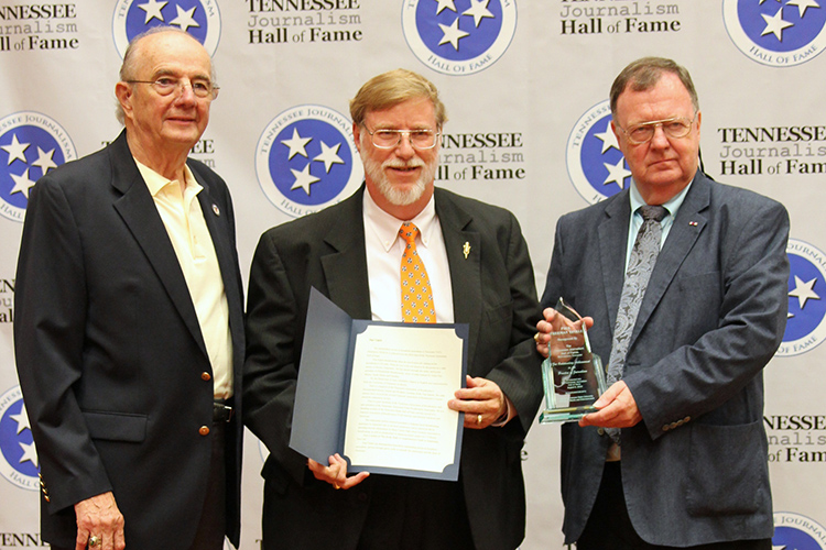 Paul Tinkle, president and general manager of Thunderbolt Broadcasting and Digital in Martin and Union City, Tenn., receives his award and certificate during the induction ceremony for the 2019 class of the Tennessee Journalism Hall of Fame held Tuesday, Aug. 6, at Embassy Suites in Murfreesboro, Tenn. Shown with him are Hooper Penuel, left, TJHOF co-founder and secretary, and TJHOF President Larry Burriss. (Submitted photo)