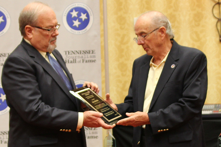 Tennessee Journalism Hall of Fame co-founder and secretary Hooper Penuel, right, presents Ron Fryar, owner and publisher of the Cannon Courier, with a special plaque in memory of hall co-founder and 2018 Dan Whittle, a friend of both of died in April after a long battle with leukemia. The 2019 class was inducted during a special ceremony held Tuesday, Aug. 6, at Embassy Suites in Murfreesboro, Tenn. (Submitted photo)