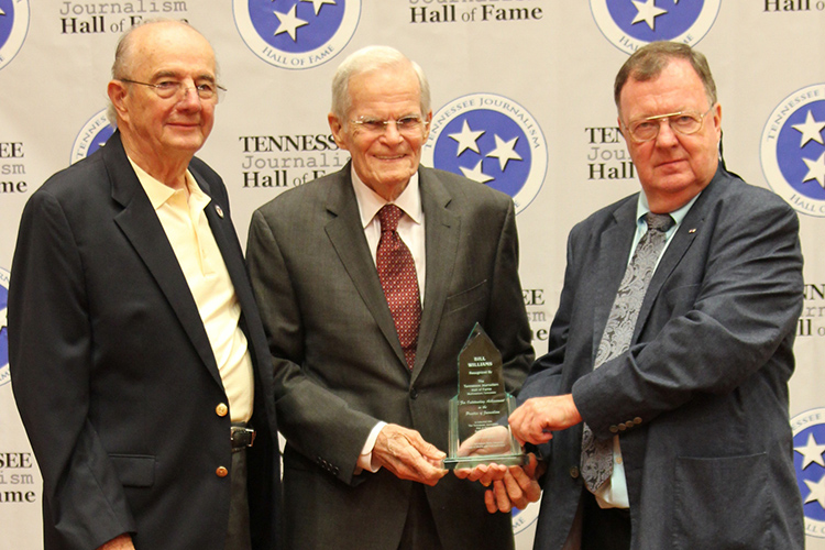 Bill Williams, center, retired Anchor Emeritus and special reporter for WBIR-TV in Knoxville, Tenn., receives his award and certificate during the induction ceremony for the 2019 class of the Tennessee Journalism Hall of Fame held Tuesday, Aug. 6, at Embassy Suites in Murfreesboro, Tenn. Shown with him are Hooper Penuel, left, TJHOF co-founder and secretary, and TJHOF President Larry Burriss. (Submitted photo)