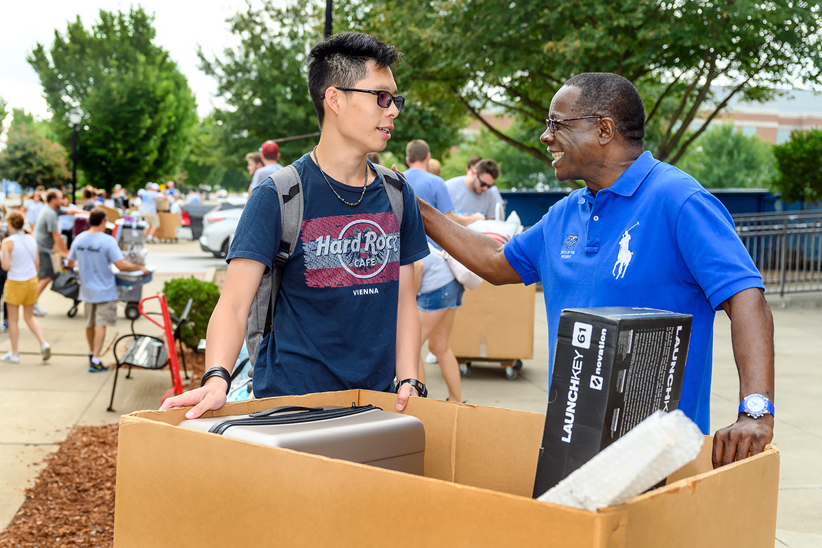 Leo Sun, left, an MTSU freshman form Hsinchu, Taiwan, is greeted by MTSU President Sidney A. McPhee Friday, Aug. 23, on the first of two days of We-Haul, a volunteer effort to help new students move into campus housing. Sun, who is an audio production major, was helped on the move-in by his mother, Sophia Chung, who also met McPhee. (MTSU photo by J. Intintoli)