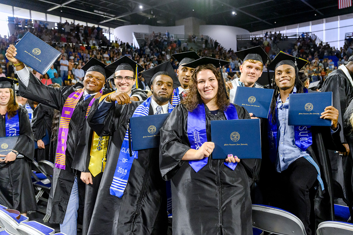 A newly minted group of MTSU's Class of 2019 proudly display their degrees as they prepare to leave Murphy Center Saturday, Aug. 10, after the university's summer 2019 commencement ceremony. MTSU awarded 817 degrees during the event to 603 undergrads and 214 graduate students. (MTSU photo by J. Intintoli)