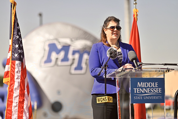 State Sen. Dawn White, an MTSU alumna, praises the university's faculty and staff for producing 'thousands' of area graduates at the Thursday, Sept. 5, dedication ceremony of the newly named Blue Raider Bridge. (MTSU photo by J. Intintoli)