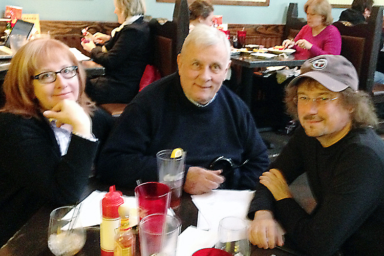 "Award-winning author Edmund White, center, enjoys a visit with Nancy McGuire Roche, left, and MTSU English professor Will Brantley, right, co-editors of ""Conversations with Edmund White"" (Photo submitted)"