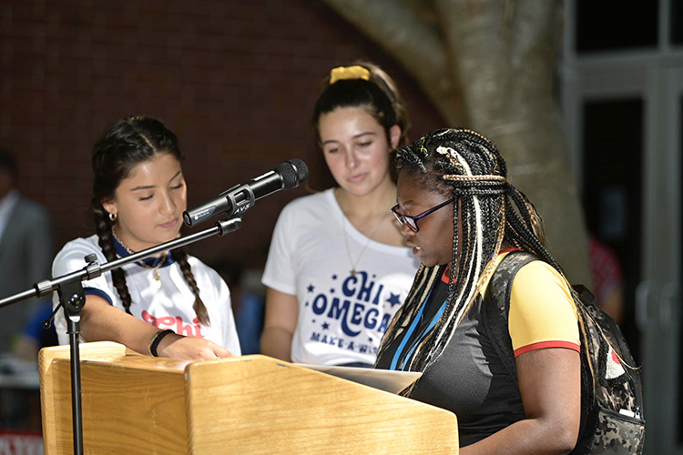 MTSU freshman Carolyn Cowan, right, reads a copy of the U.S. Constitution Tuesday, Sept. 17, as part of MTSU's 2019 Constitution Day celebration. Also pictured is junior Alexa Cobain, left, and sophomore Reily Brazier, center. Readings were held at multiple locations around campus. (MTSU photo by Andy Heidt)