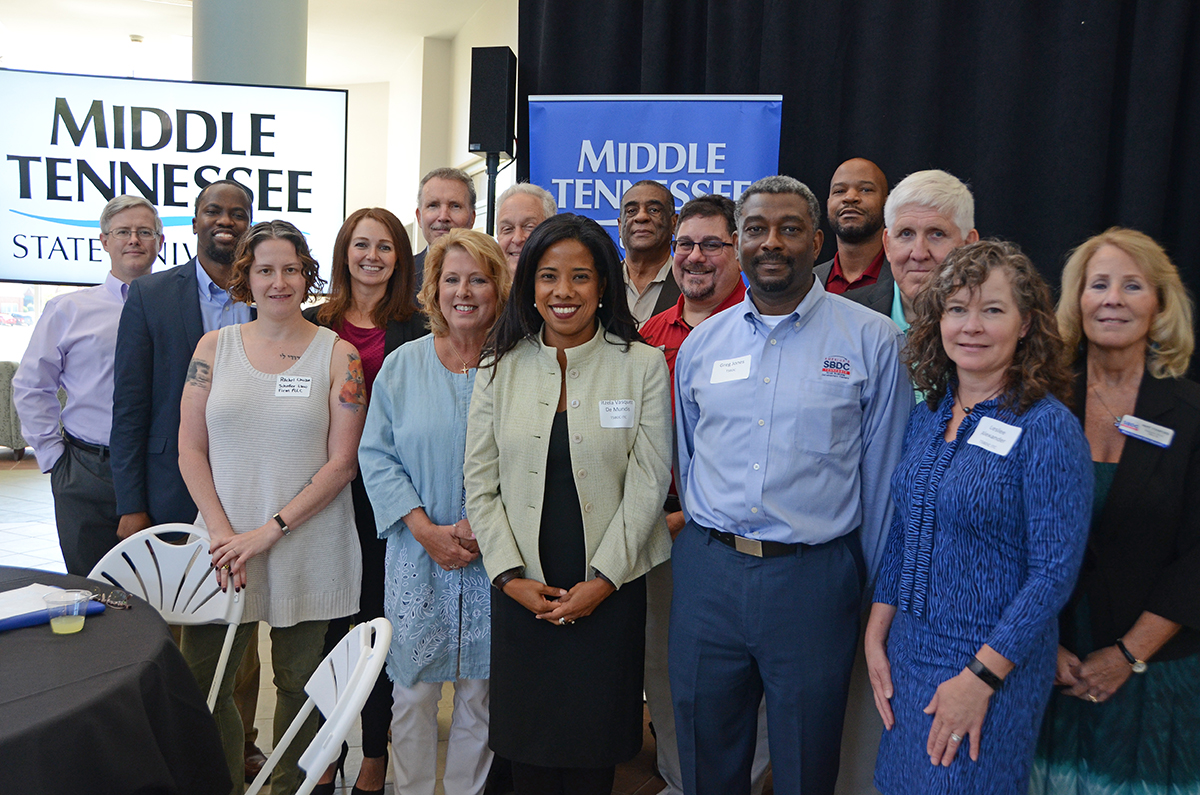 Organizers and presenters for the inaugural Tennessee Craft Beer and Spirit Distilleries International Sales Opportunities Forum gather before the start of the Aug. 27 session in the Miller Education Center atrium. (MTSU photo by Randy Weiler)