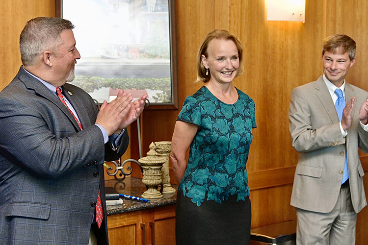 Former Tennessee House Speaker Beth Harwell, center, smiles Tuesday, Sept. 24, inside the MTSU Student Union Building as she is formally introduced as a Distinguished Visiting Professor in political science. Also pictured are Steve Sandlin, left, deputy to the Rutherford County mayor, and Charlie Baum, MTSU economics professor and state representative. (MTSU photo by Andy Heidt)