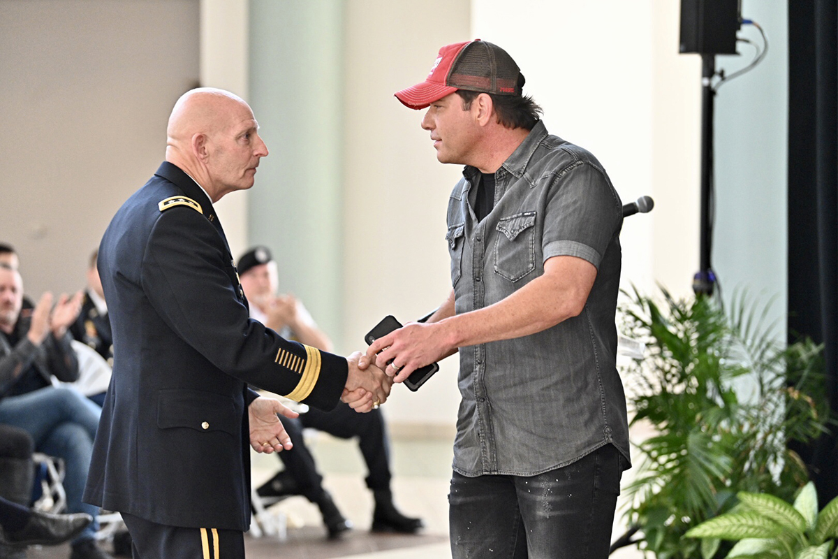 MTSU veterans adviser and retired Lt. Gen. Keith M. Huber, left, shakes hands with country music entertainer Rodney Atkins after the musician's announcement of a Sept. 11, 2020, concert in Murphy Center to commemorate Daniels Veterans Center's 9/11 Remembrance activities in 2020. They attended this year's 9/11 ceremony in the Miller Education Center atrium. (MTSU photo by J. Intintoli)