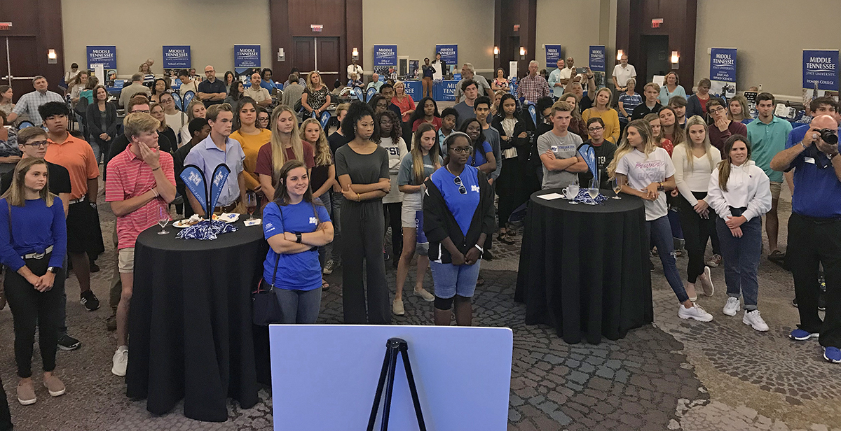 The crowd attending the MTSU True Blue Tour event in Huntsville, Ala., Wednesday, Sept. 25, listens as university President Sidney A. McPhee shares news about a new guaranteed $8,000 scholarship for students with a 23 or 24 ACT and 3.5 or higher GPA. (MTSU photo by Randy Weiler)