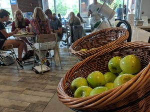 Fresh fruit sits on dimply in wicker baskets at the Farmers Market, ready for students to enjoy.