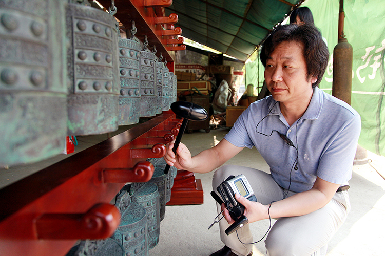 Music archaeologist Li Youping performs on the bronze bells that are thought in Chinese culture to harmonize heaven and earth. He will lecture and perform Sept. 26 at MTSU's Miller Education Center. (Photo submitted)