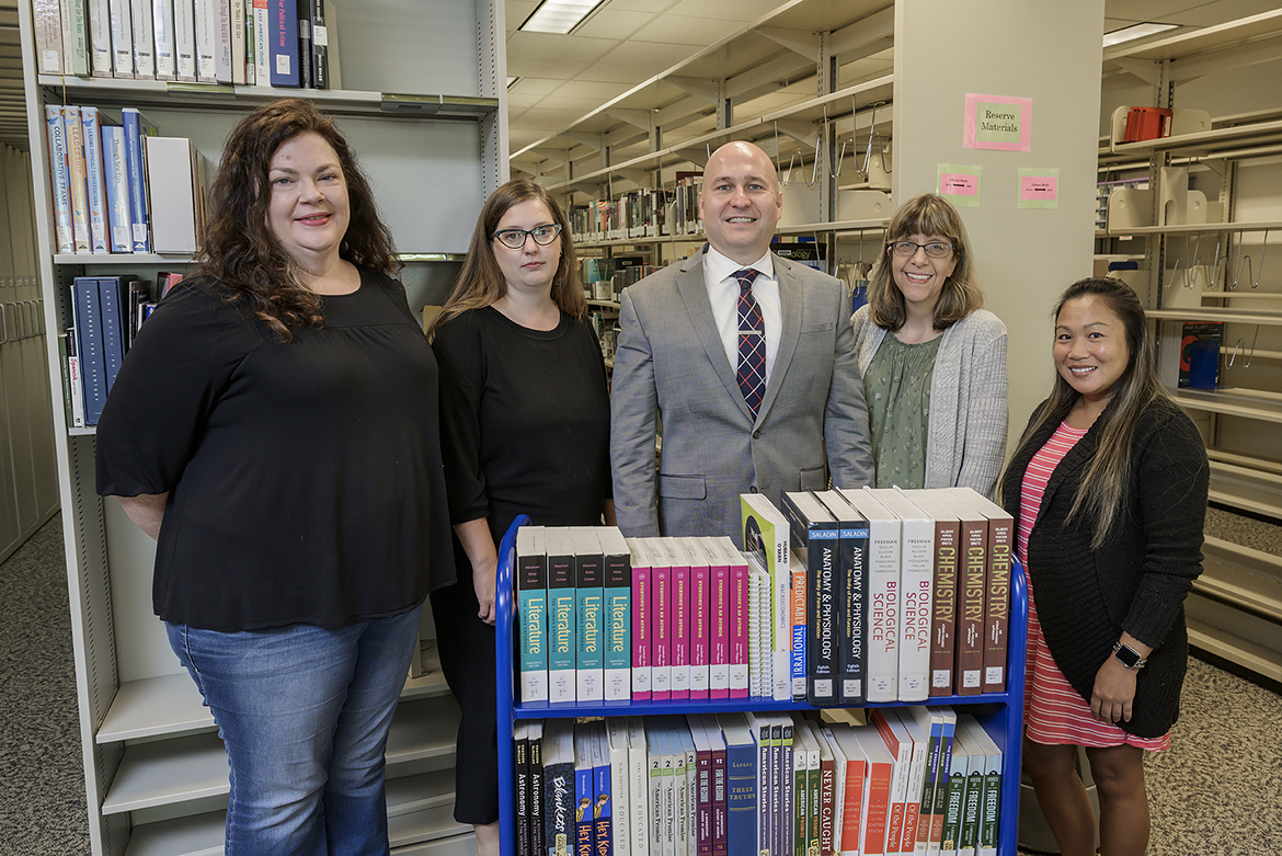 Wendy Jones, acquisitions assistant, left; Suzanne Mangrum, acquisitions librarian and interim chair of collection development and management; Dr. Jason Martin, interim dean, James E. Walker Library; Suzy Burkhardt, library assistant; and Anne Sayakhom, acquisitions assistant. (MTSU photo by Andy Heidt)