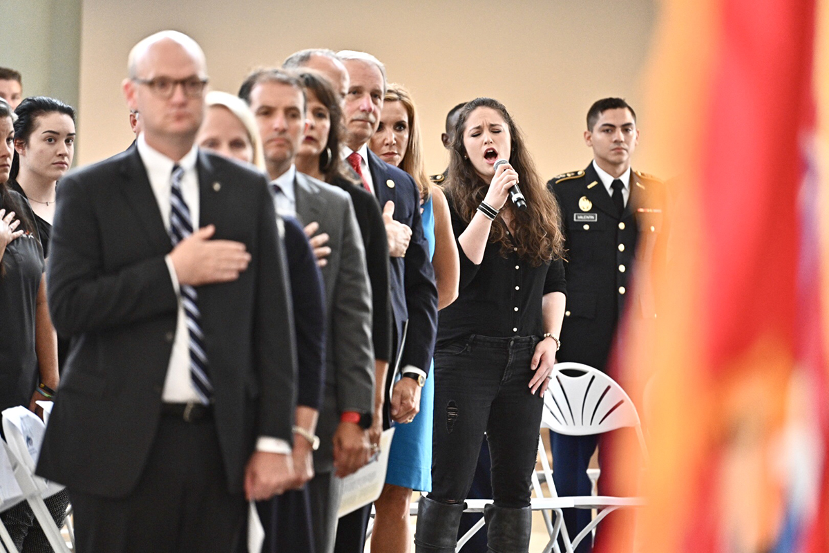 Country music singer Rachel Lipsky of Nashville, Tenn., sings the national anthem, Wednesday, Sept. 11, during MTSU's fifth annual 9/11 Remembrance at the Miller Education Center atrium. (MTSU photo by J. Intintoli)