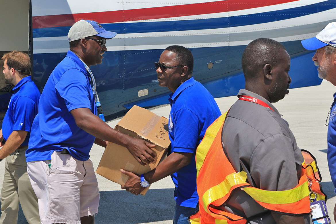 MTSU Trustees Vice Chair Darrell Freeman, left, and President Sidney A. McPhee unload supplies from aircraft that flew to the Bahamas as part of the second wave of Raider Relief on Sept. 11. (MTSU Photo by John Goodwin)