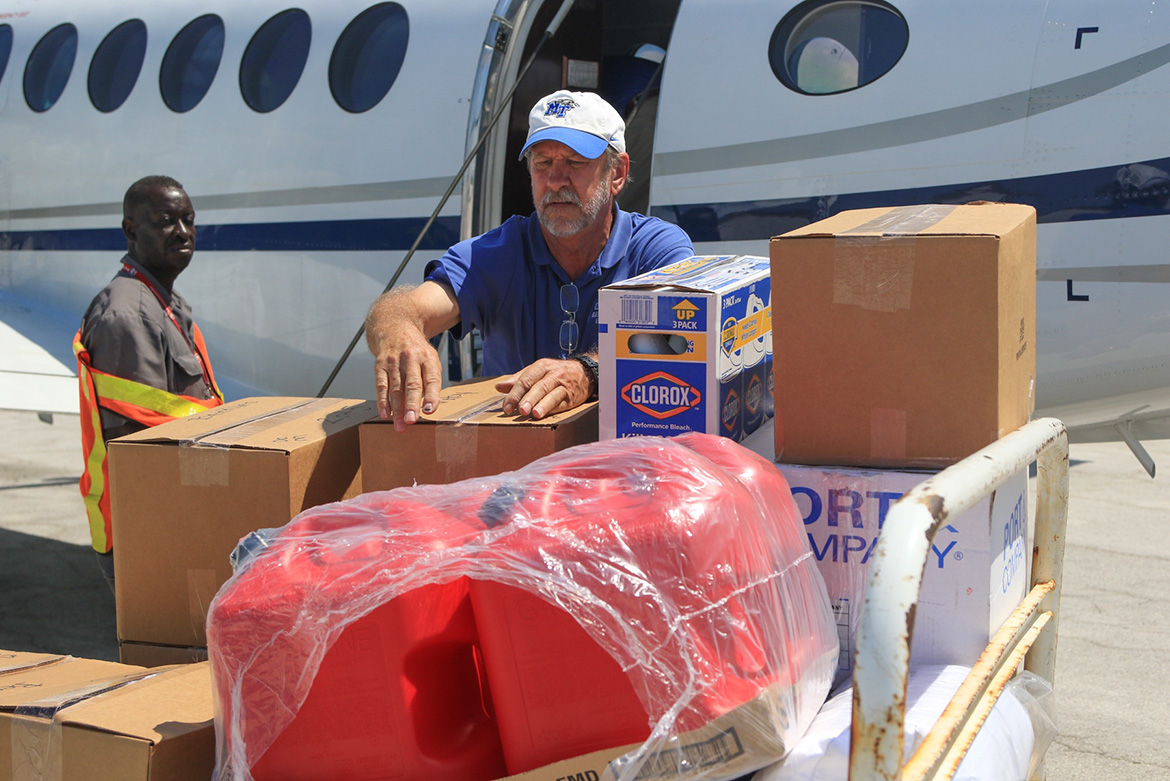 Officials and volunteers supporting MTSU's Raider Relief drive unload humanitarian supplies from one of two aircraft flown to Freeport, Bahamas, on Sunday, Sept. 8. (MTSU Photo by John Goodwin)