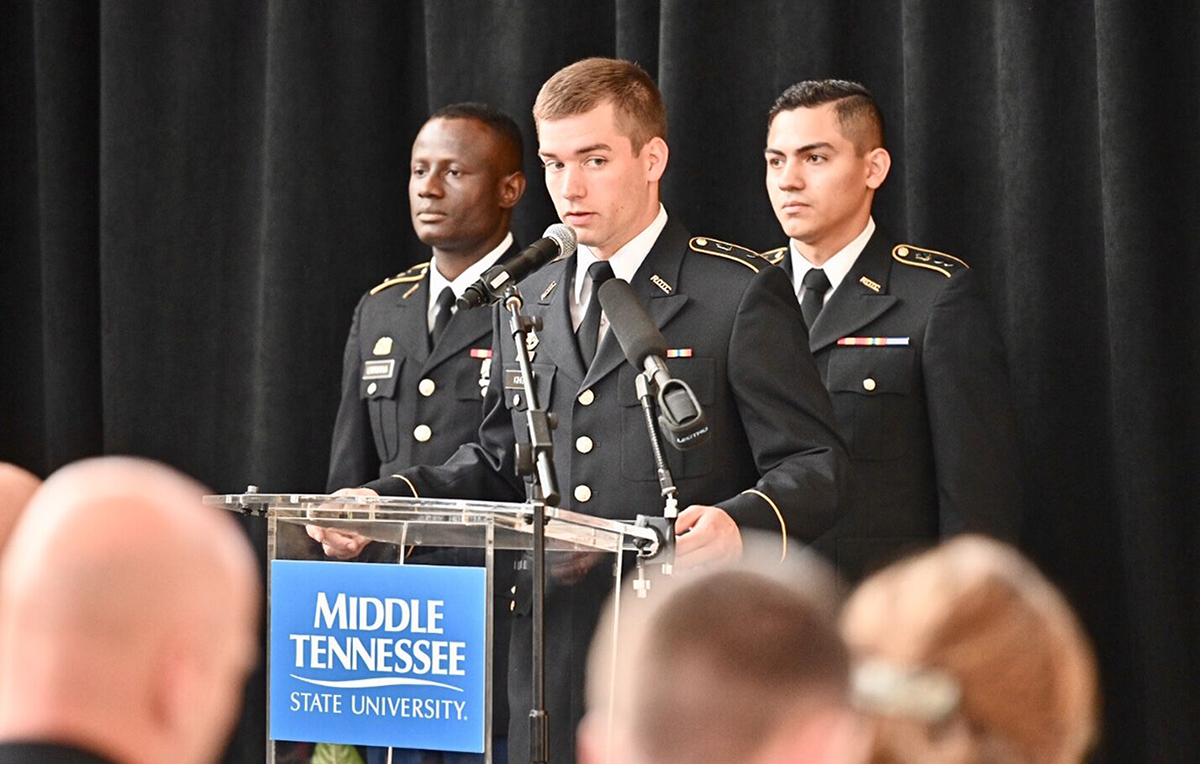 ROTC senior cadet Nick King, center, takes his turn reading the Sept. 11, 2001, timeline of events Wednesday, Sept. 11, during the fifth annual MTSU 9/11 Remembrance in the Miller Education Center atrium. Awaiting their turns to read are junior Fabrice Uwimana, left, and senior Brandon Valentin. (MTSU photo by J. Intintoli)