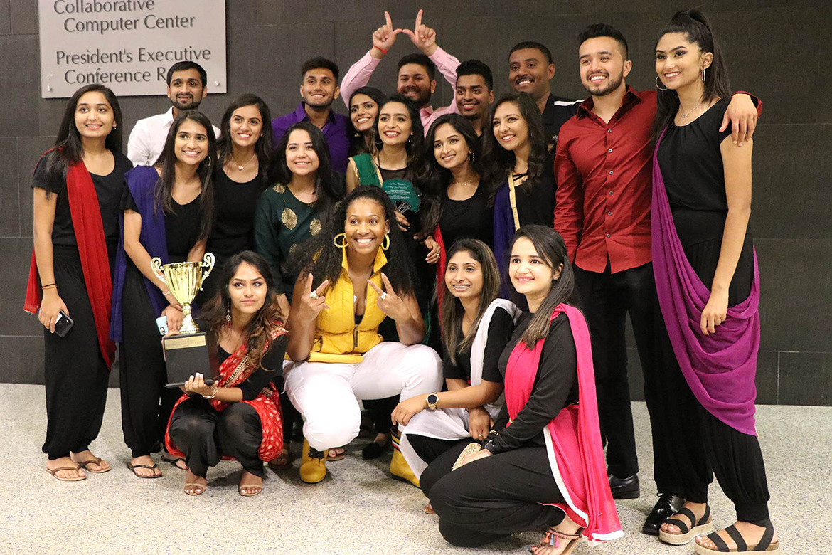 Members of the Indian Cultural Exchange Organization are all smiles as they pose with their first place trophy after winning the 2019 Rep Your Roots talent showcase held Friday, Sept. 20, in the Student Union atrium. (Submitted photo)