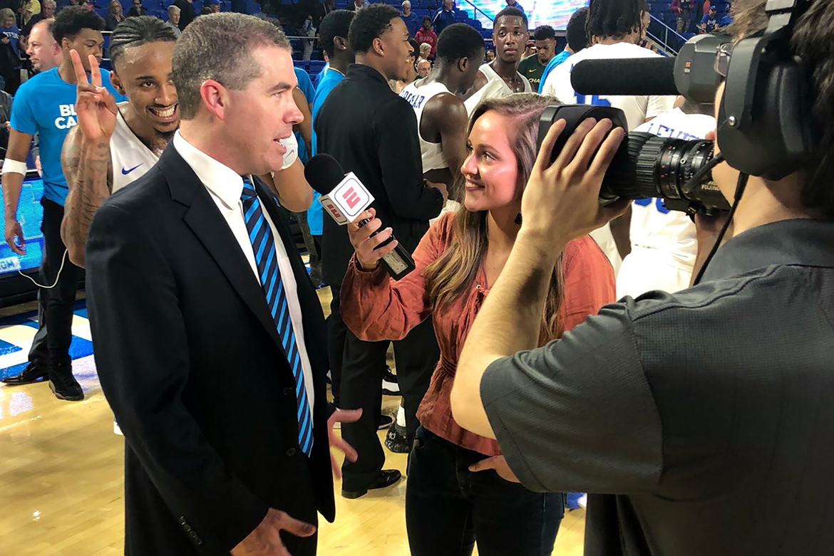 MTSU College of Media and Entertainment senior Kaitlyn Runion interviews MTSU men's basketball coach Nick McDevitt following a game at Murphy Center. Runion has had opportunities to be a sideline reporter for ESPN+ broadcasts of MTSU men's and women's basketball games. (Submitted photo)