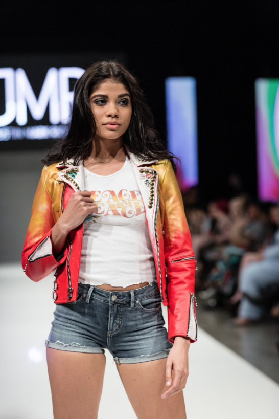Model standing on runway during Nashville Fashion Week 2019 event representing designer Justin Mark Richards. Photo by John Hillin.