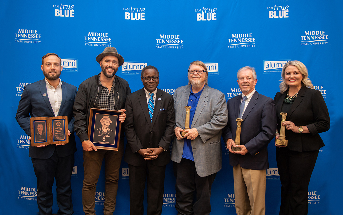 MTSU President Sidney A. McPhee, third from left, greeted the 2019-20 MTSU Distinguished Alumni: Aaron Shew, left, Young Alumni Achievement Award; Jeremy Cowart, overall Distinguished Alumnus; and Citations of Distinction recipients Carroll Van West (Achievement in Education/MTSU faculty), G. Edward Hughes (Achievement in Education/non-MTSU); and Meagan Flippin (Service to Community). The awards were presented Friday, Oct. 25, in the Ingram Building's MT Center. (MTSU photo by James Cessna)