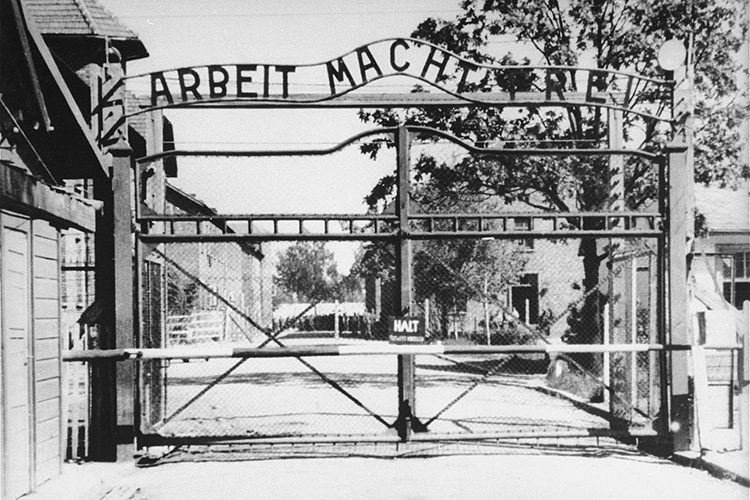 "This file photo from the United States Holocaust Memorial Museum archives, taken in May 1945, shows the entrance to the main camp of Auschwitz in southern Poland. The gate bears the motto ""Arbeit Macht Frei,"" or ""work makes one free."" (Photo from Instytut Pamieci Narodowej, or The Institute of National Remembrance – Commission for the Prosecution of Crimes against the Polish Nation, courtesy of USHMM Photo Archives)"