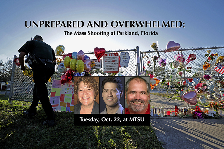 A Broward County Sheriff's Office deputy removes police tape from a makeshift memorial at Marjory Stoneman Douglas High School in Parkland, Fla., Sunday, Feb. 18, 2018. Three South Florida Sun Sentinel staffers will speak at MTSU Oct. 22 on the paper's 2019 Pulitzer Prize win for the staff's investigative coverage of the massacre. (John McCall/South Florida Sun-Sentinel via AP)