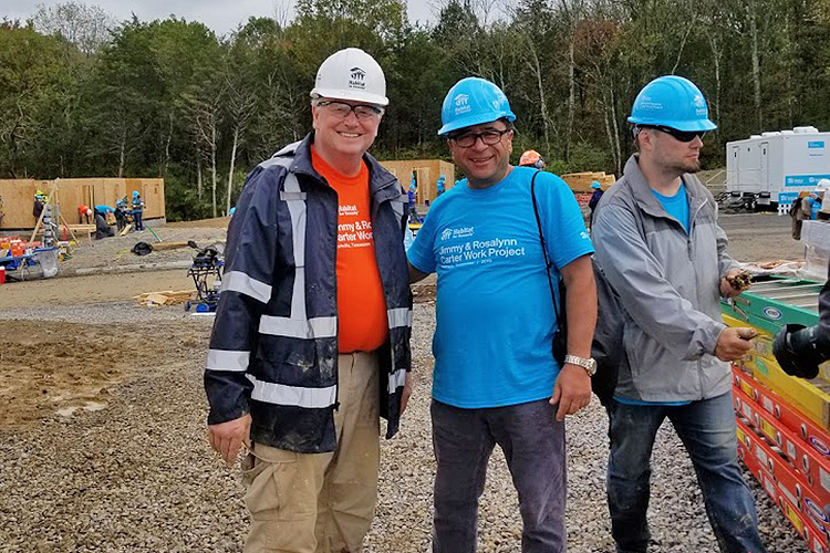 Murat Arik, right, director of MTSU's Business and Economic Research Center, and Tom Wallace, an associate vice president in MTSU's Information Technology Division, pose for a photo Oct. 7 at the site of the Carter Work Project 2019 Habitat for Humanity build in Nashville, Tenn. (Submitted photo)