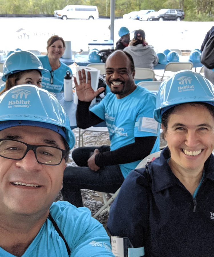 Murat Arik, left, director of MTSU's Business and Economic Research Center, and his wife, Hulya, right, pose for a selfie with other volunteers Oct. 7 at the site of the Carter Work Project 2019 Habitat for Humanity build in Nashville, Tenn. (Submitted photo)