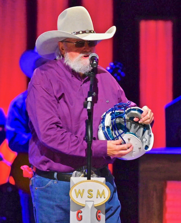 Country Music Hall of Famer Charlie Daniels, namesake and patron of MTSU's Charlie and Hazel Daniels Veterans and Military Family Center, speaks to the Grand Ole Opry audience after receiving a surprise gift from MTSU during his Oct. 15 show in Nashville, Tenn. (MTSU photo by Cat Curtis Murphy)