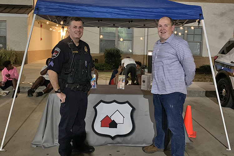 Murfreesboro Police Department Sgt. Harry Haigh, left, coordinator of the Murfreesboro Crime Free Multi-Housing program, and MPD Chief Michael Bowen, staff an event to celebrate one-year anniversary of College Center Apartments certification in the program. (Photo courtesy of the City of Murfreesboro)
