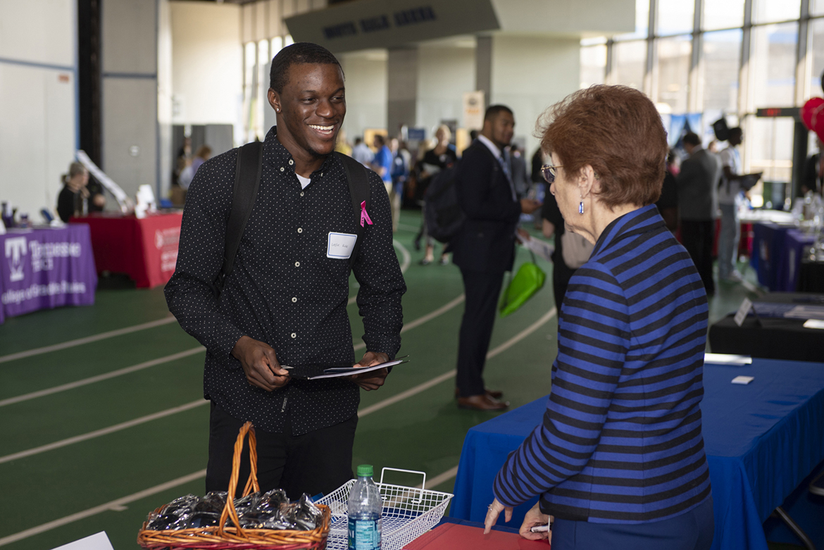 MTSU student Leslie Rolle, left, a senior University College major, speaks to a recruiter during the Oct. 3 MTSU Fall Career Fair at Murphy Center. (MTSU photo by James Cessna)