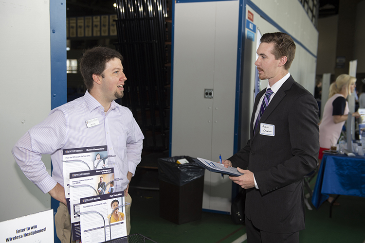 MTSU student Austin Osborn, right, a senior business major, speaks with Will Scism, a graduate school recruiter for Lipscomb University in Nashville, Tenn., during the Oct. 3 MTSU Fall Career Fair at Murphy Center. (MTSU photo by James Cessna)