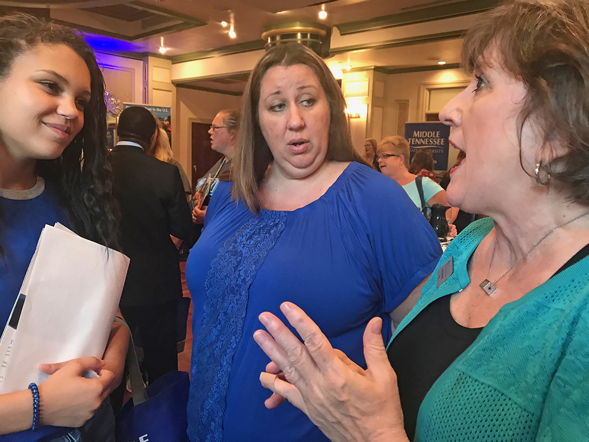Kyla Gillespie, left, of Greeneville, Tenn., wants to teach third-graders some day. She and her mother, Jamie Gillespie, listen to MTSU College of Education Dean Lana Seivers discusses what it takes to become a K-12 teacher Tuesday, Oct. 1, during the MTSU True Blue Tour event at the Carnegie Hotel in Johnson City. Kyla Gillespie, 17, is a senior at Greeneville High School. (MTSU photo by Randy Weiler)