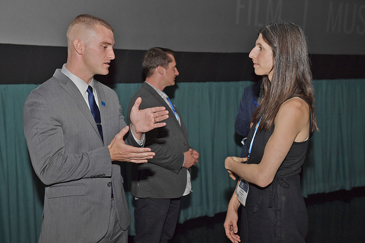 """MTSU doctoral candidate and Marine veteran Corbitt Huseth, left, chats with Danielle Bernstein, producer, editor and co-director of the documentary """"Homemade,"""" following a screening of the film Thursday, Oct. 10, at Regal Hollywood 27 as part of the Nashville Film Festival. MTSU is a festival sponsor. (MTSU photo by James Cessna)"""