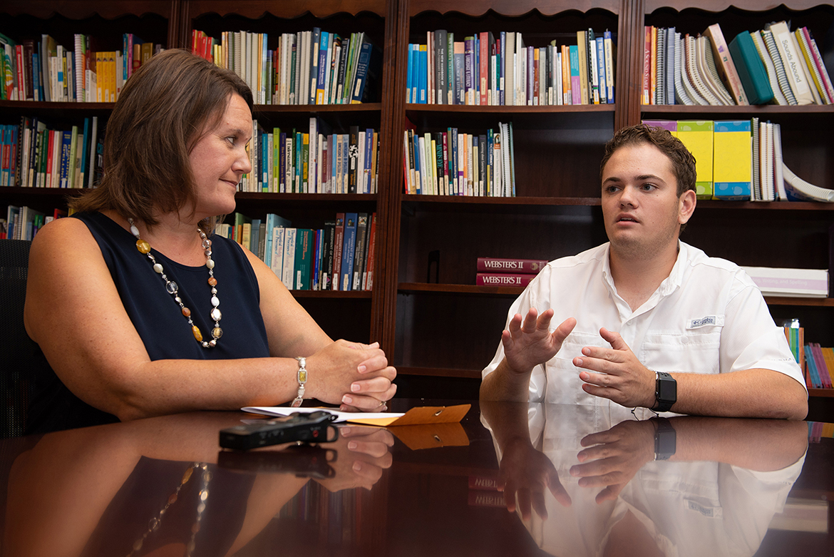 Aaron Lile, right, an MTSU mechatronics major who benefitted from childhood assistance from the Tennessee Center for the Study and Treatment of Dyslexia, and his mother, Dawn Lile, who attended several workshops for parents at the center to help her son, listens as her son describes what it's like to try to read while struggling with dyslexia. (MTSU photo by James Cessna)