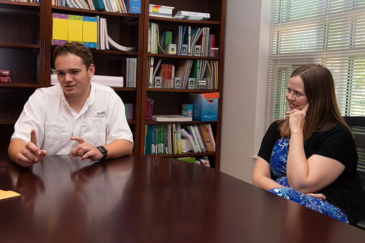 Aaron Lile, left, and Erin Alexander, assistant director for clinical services at the Tennessee Center for the Study and Treatment of Dyslexia (MTSU photo by James Cessna)
