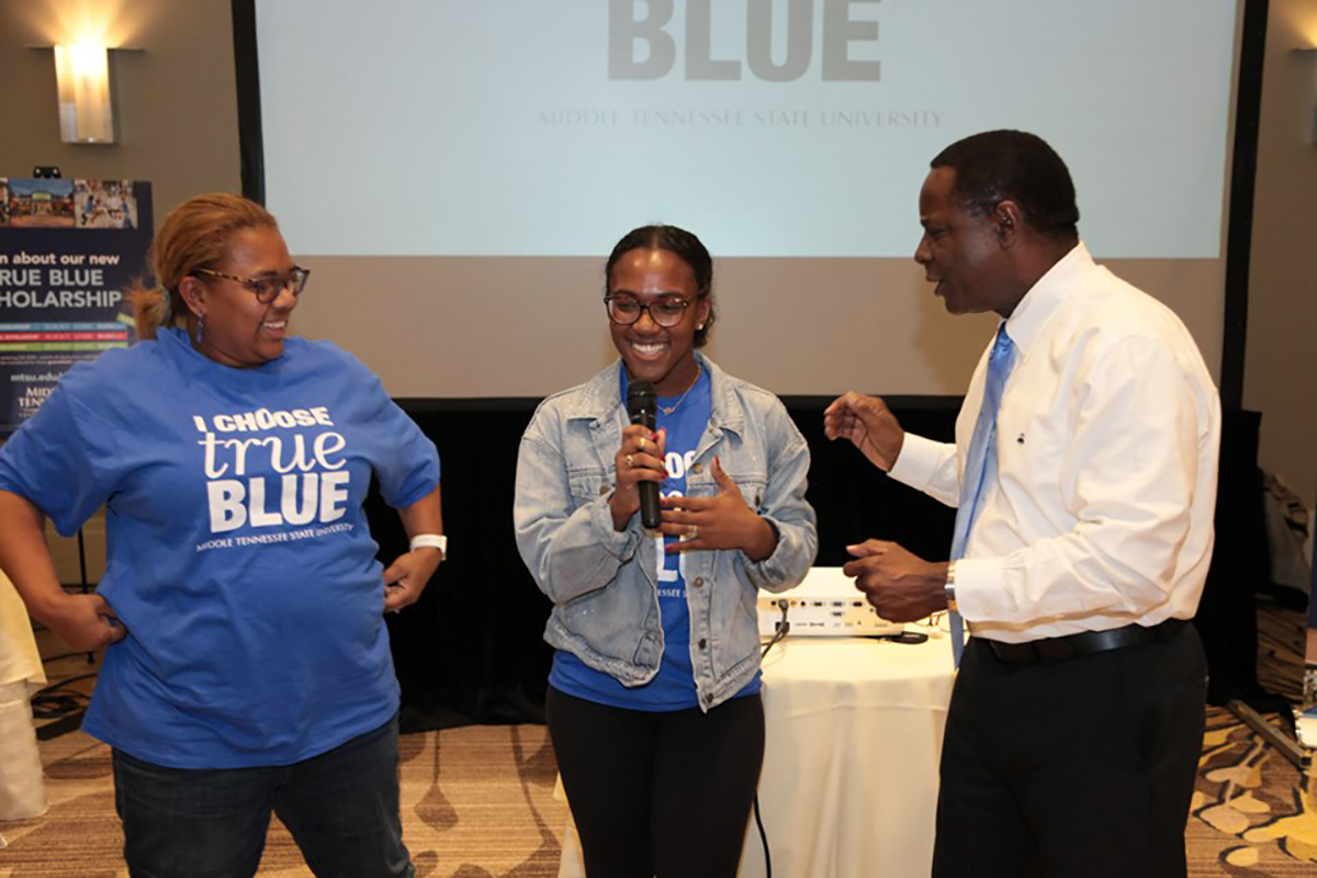 MTSU President Sidney A. McPhee, right, and Fran Turner, left, listen as Eden Turner talks about herself and what she likes about MTSU during the True Blue Tour visit to Atlanta, Ga., Tuesday, Oct. 30, at the Hyatt Regency Atlanta Perimeter at Villa Christina. Eden Turner won a $9,000 scholarship. (MTSU photo by John Goodwin)