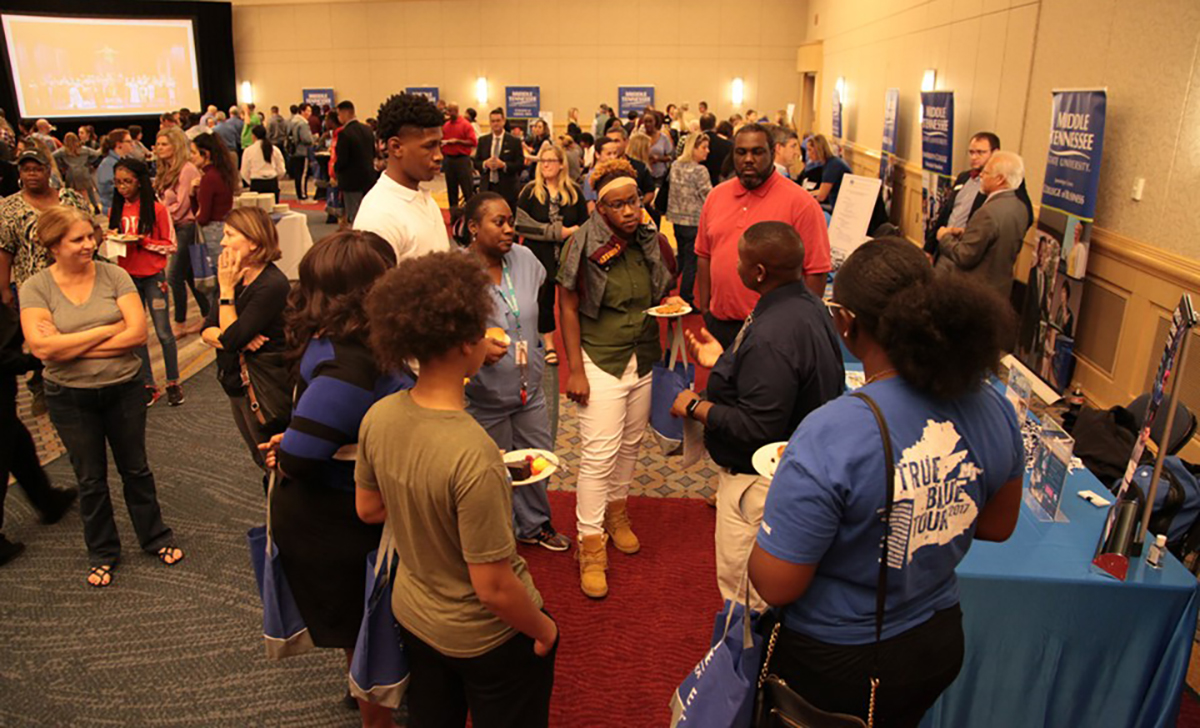 MTSU's Travis Strattion, second from right, tells a group of prospective students and their parents about the Office of Student Success and other MTSU departments share about their opportunities Tuesday, Oct. 29, during the True Blue Tour in Chattanooga, Tenn., at the Chattanooga Convention Center. (MTSU photo by John Goodwin)