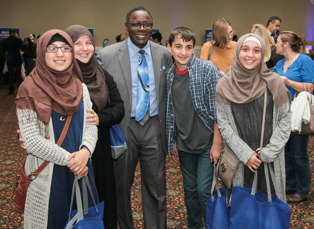 MTSU President Sidney A. McPhee, third from left, meets future MTSU Blue Raiders — Fatimah, Khaeijah, Ahmed and Zaynab Alnassar — Tuesday, Oct. 22, during the True Blue Tour event in Nashville at the Millennium Maxwell House Hotel. Khaeijah Alnassar's children are triplets who plan to dual enroll with MTSU while she will be a freshman in fall 2020. (MTSU photo by John Goodwin)