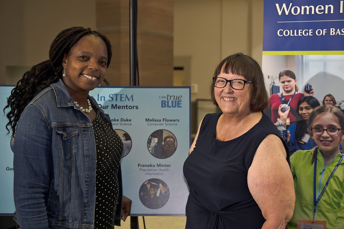 MTSU alumna Freneka Minter, left, visits with MTSU WISTEM Center Director Judith Iriarte-Gross during the 10th anniversary celebration for the center Wednesday, Oct. 9, in the Strobel Lobby. Minter is one of 18 MTSU Women in STEM mentors. (MTSU photo by Cat Curtis Murphy)