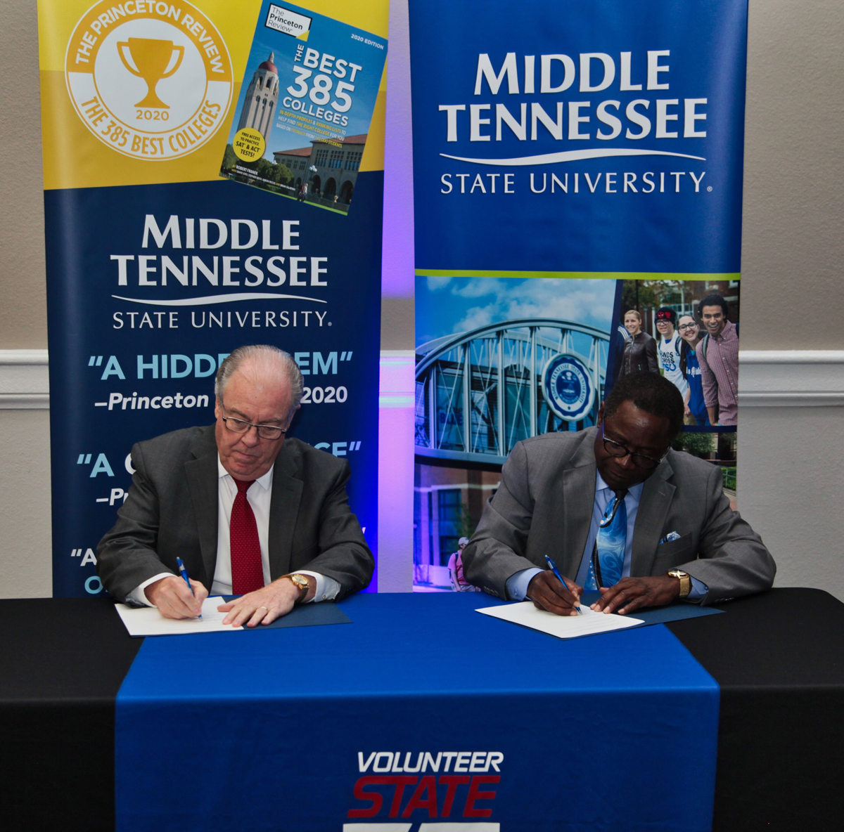 "Presidents Jerry Faulkner, left, of Volunteer State Community College and Sidney A. McPhee of Middle Tennessee State University sign an agreement marking the ""MTSU Promise"" to Vol State, the sixth such pathway established for students with associate degrees to move seamlessly to the four-year university. The signing occurred Oct. 22 at the Millennium Maxwell House Hotel in Nashville during MTSU's True Blue Tour visit to recruit students and court counselor and community college staff in Nashville. (MTSU photo by David Foster)"