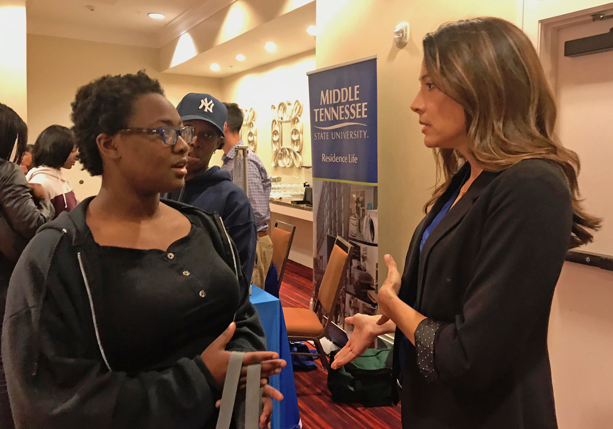 Kierra Phillips, left, a senior at Jeffersontown High School in Louisville, Ky., receives guidance about the MTSU College of Basic and Applied Sciences and has her questions answered by School of Concrete and Construction Management Director Heather Brown Wednesday, Oct. 16, during the annual True Blue Tour visit to recruit students in Louisville. Phillips' mother, Malissa Phillips, observes. (MTSU photo by Randy Weiler)