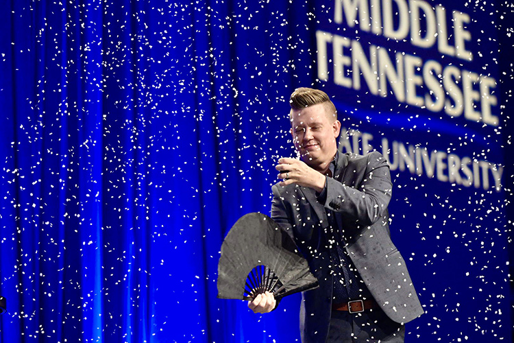Nashville illusionist and motivational speaker Harris III finishes his talk with a snowfall illusion at the 2019 Leadership Summit held Friday, Sept. 27, in the Student Union Ballroom. (MTSU photo by Andy Heidt)
